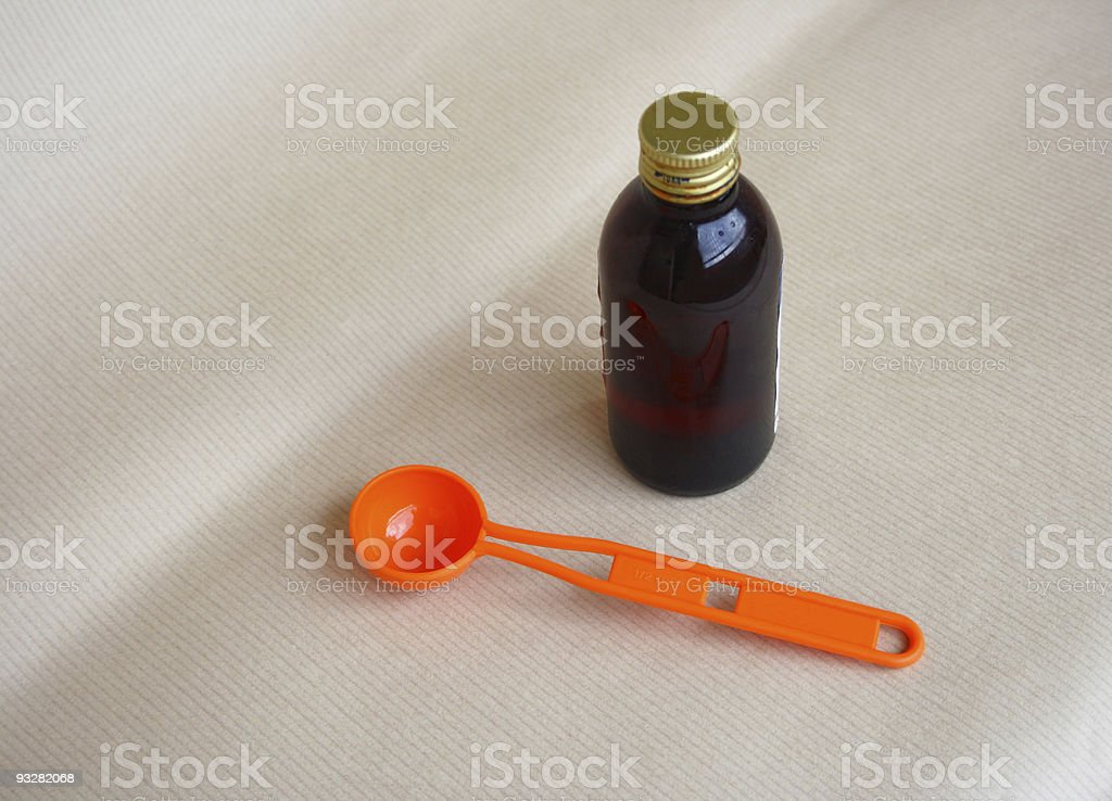 Bottle of medication and spoon stock photo