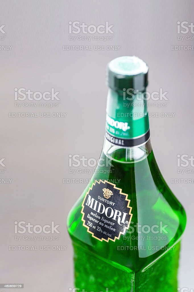 Bottle of Midori liqueur stock photo