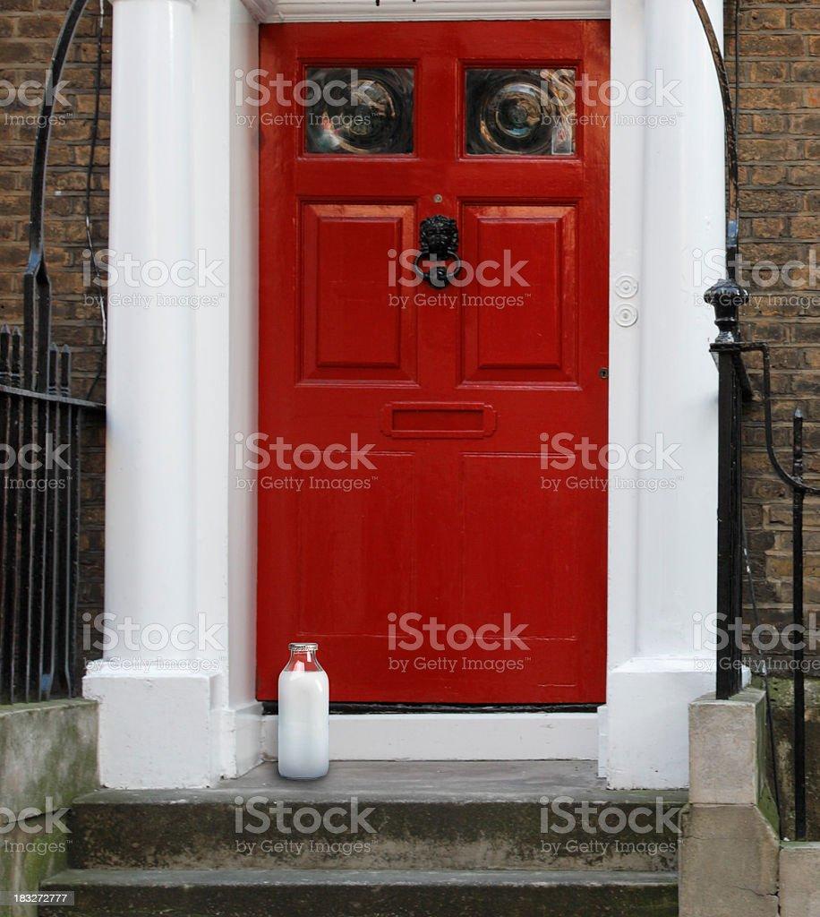 Bottle of milk on the doorstep stock photo