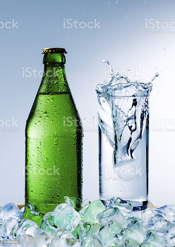 bottle of mineral water  and a glass  with ice royalty-free stock photo
