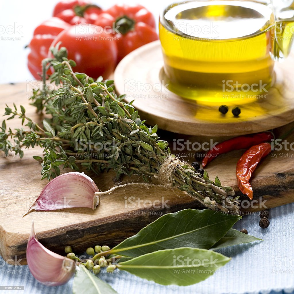 Bottle of Olive oil and condiments royalty-free stock photo