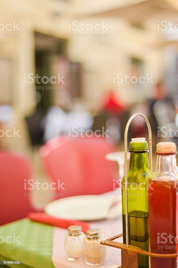 Bottle of olive oil and red wine vinegar on table stock photo