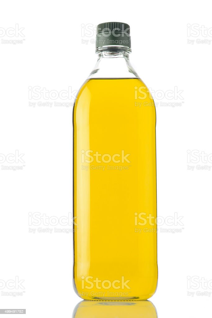 Bottle of Olive Oil on White Background Shot in Studio. stock photo
