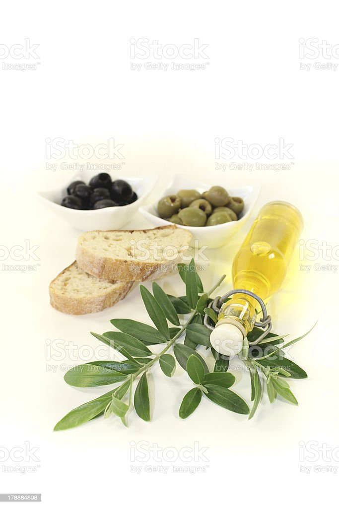 Bottle of olive oil with olives and branch royalty-free stock photo