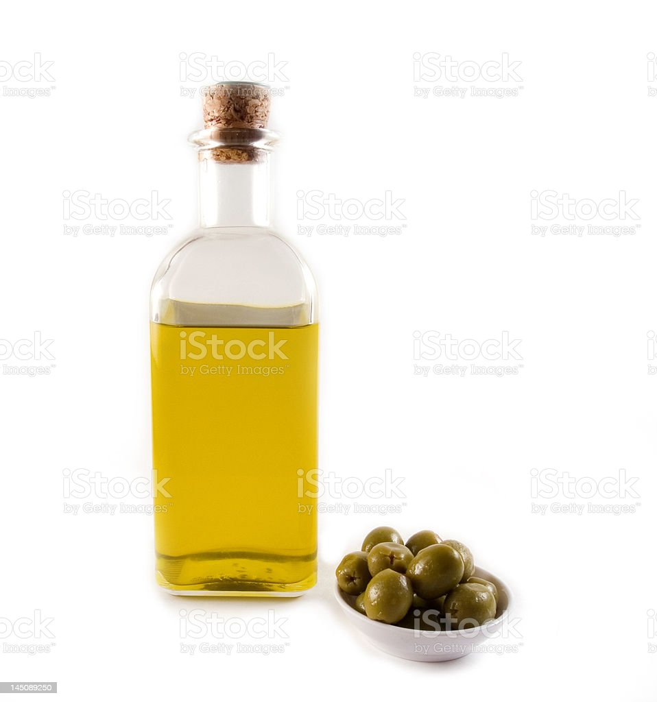 Bottle of olive oil with olives royalty-free stock photo