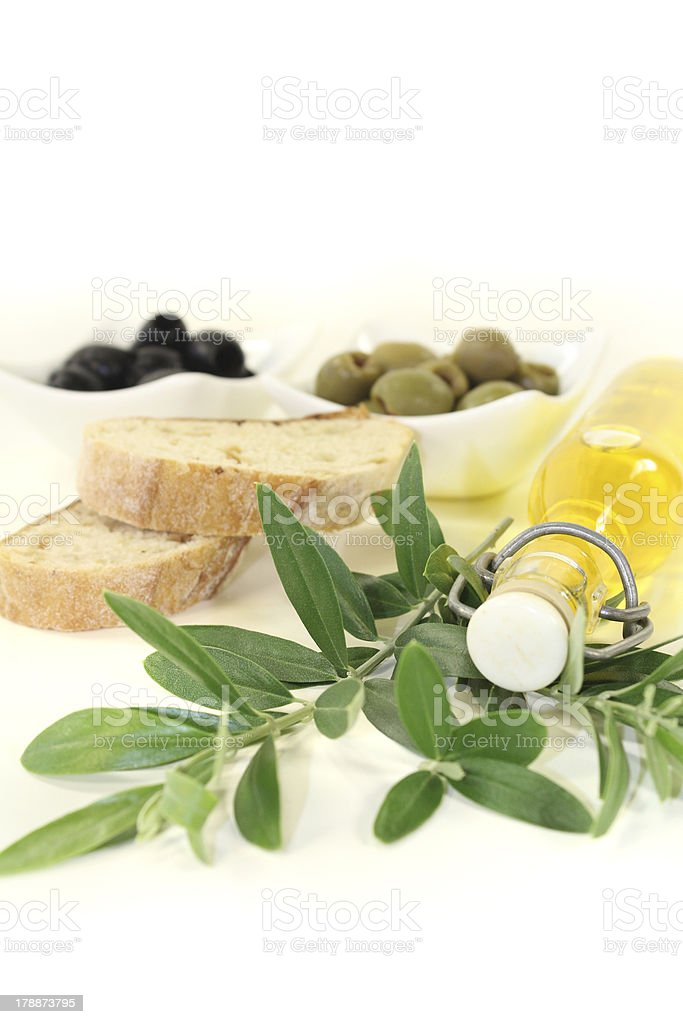 Bottle of olive oil with olives stock photo