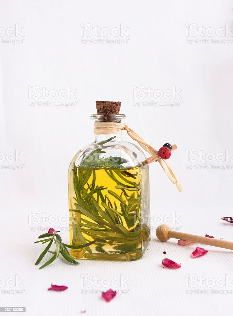 Bottle of olive oil, with  rosemary. stock photo