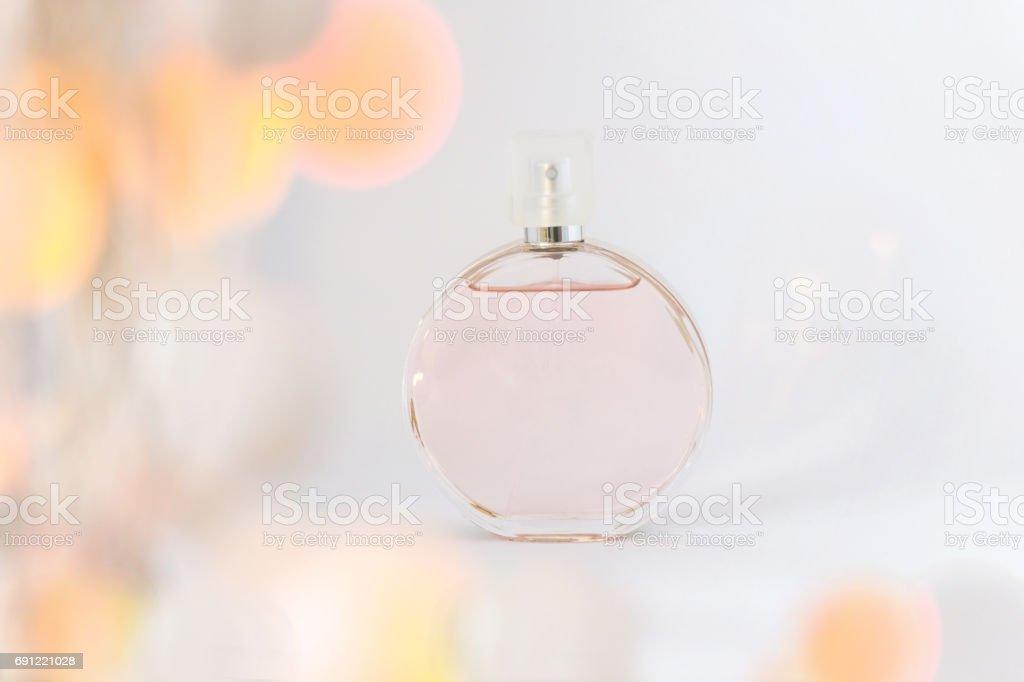 Bottle of perfume on a white background, grace and freshness, with...