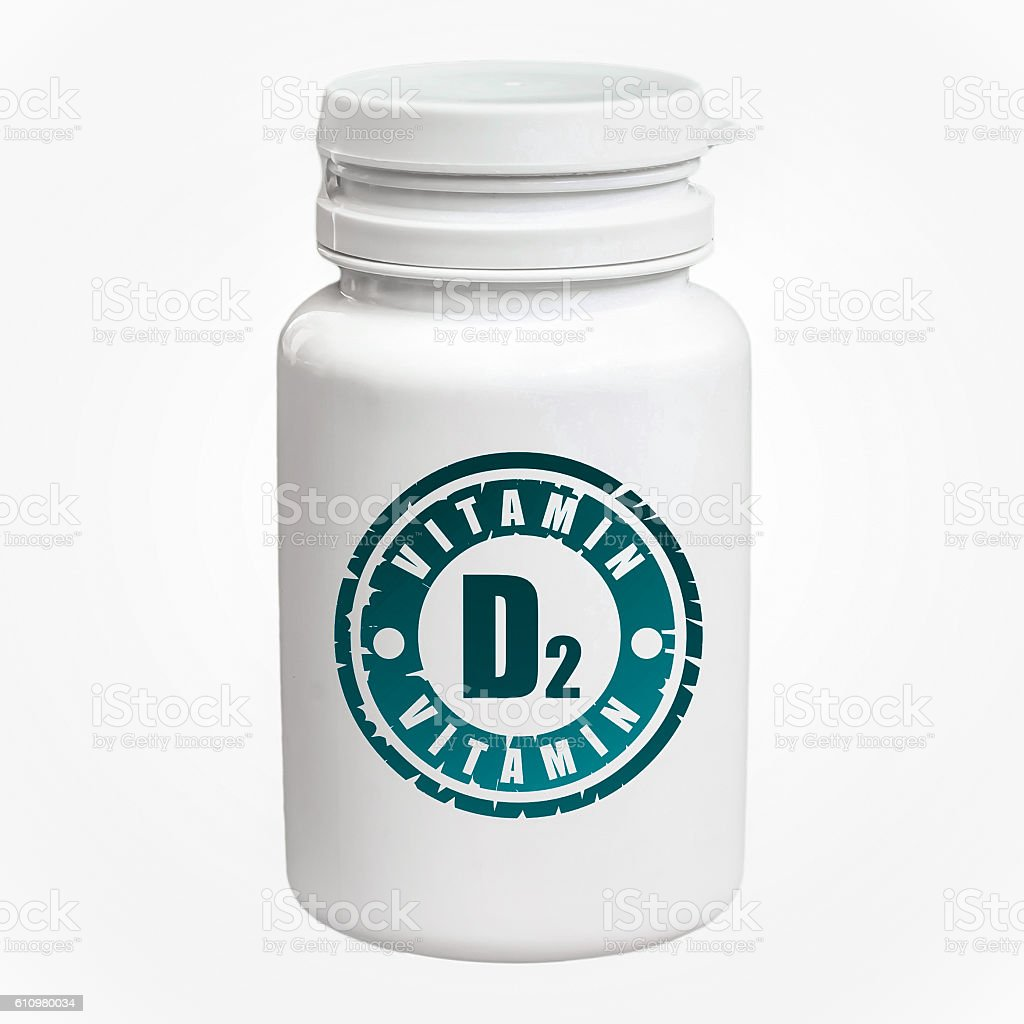 Bottle of pills with vitamin D2 stock photo