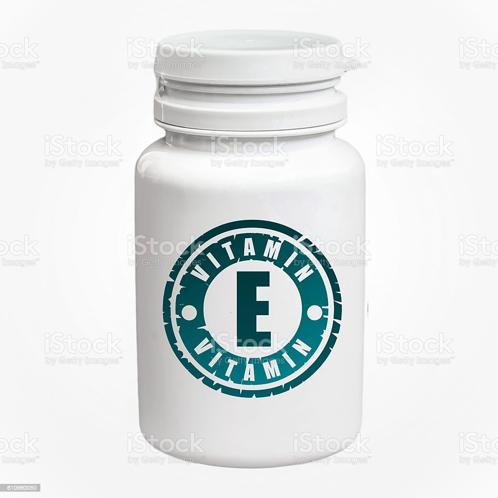 Bottle of pills with vitamin E stock photo
