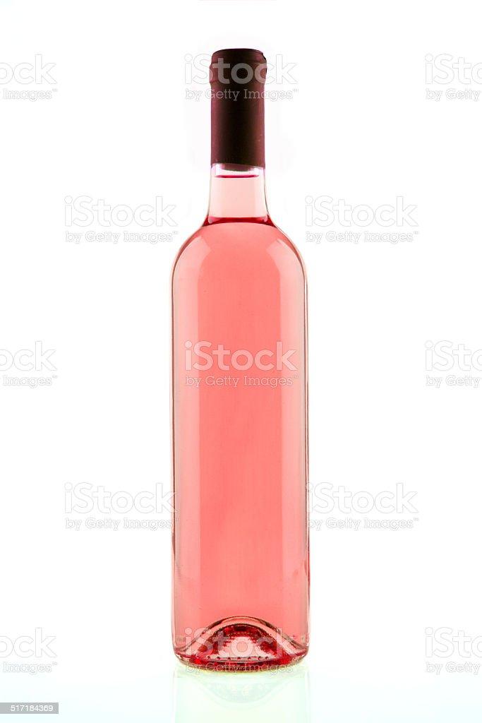 Bottle of pink rose wine isolated stock photo