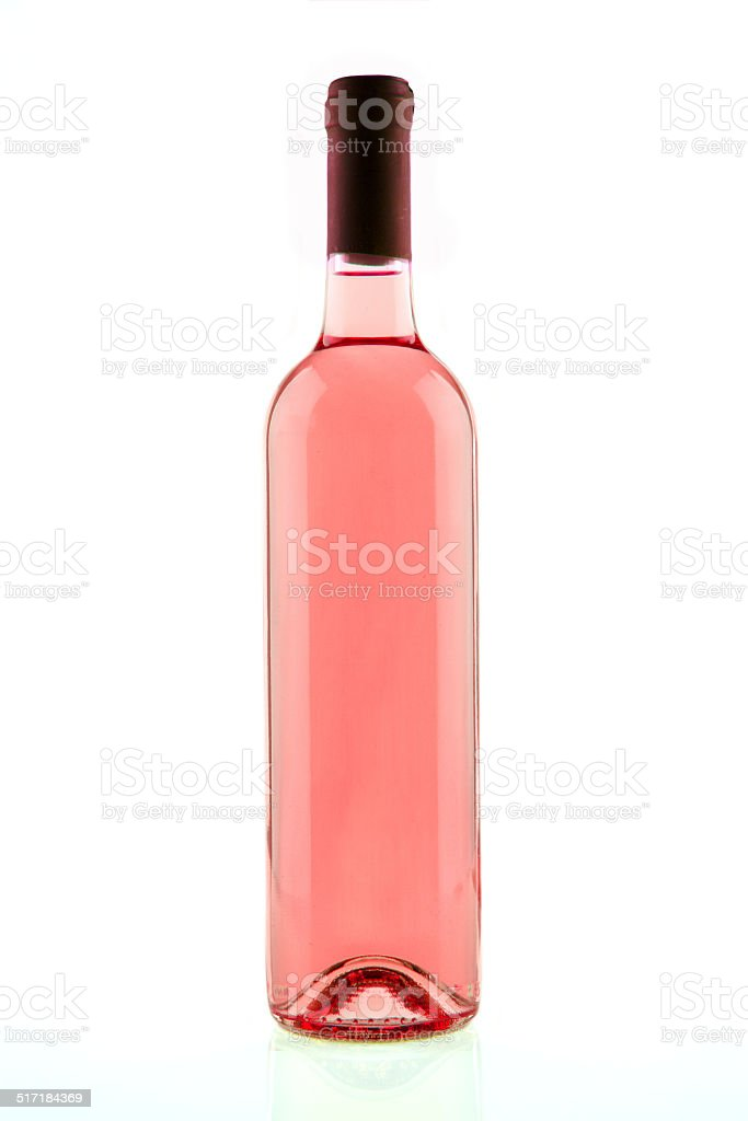 Bottle of pink rose wine isolated stock photo