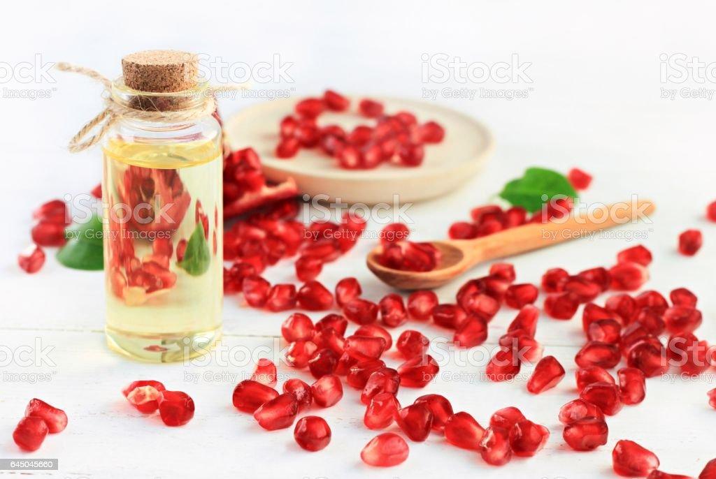 Bottle of pomegranate oil. stock photo