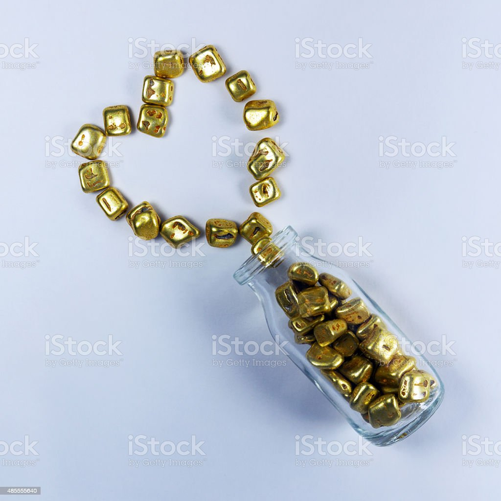 Bottle of red heart candy, candy gold stock photo