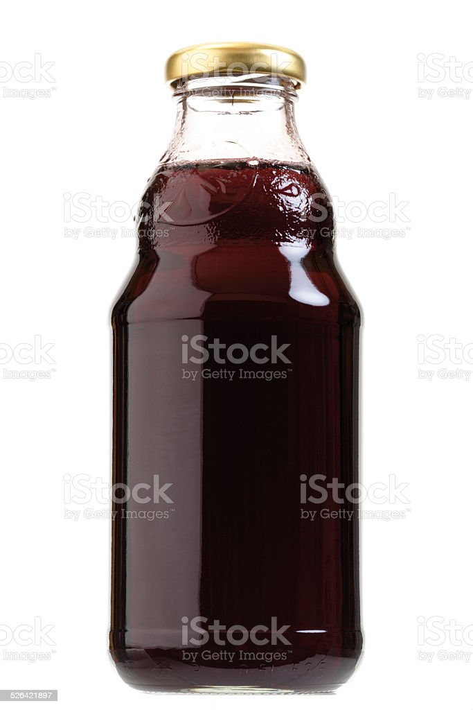 Bottle of red liquid stock photo