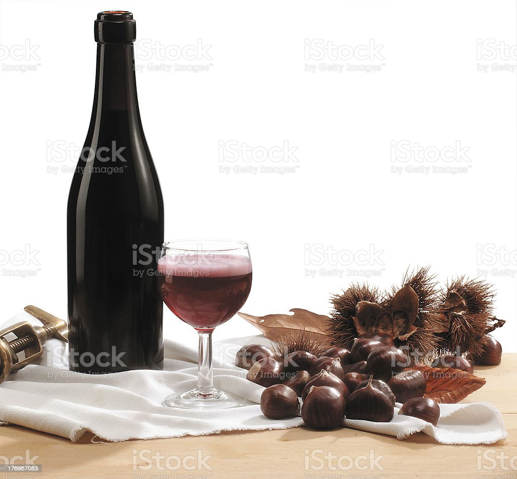 Bottle of red wine and chestnuts royalty-free stock photo