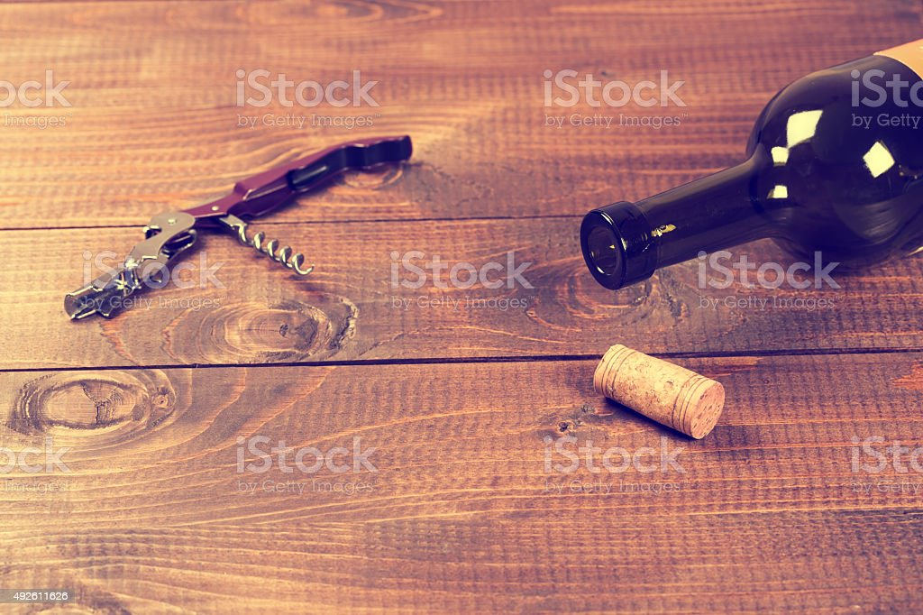 Bottle of red wine and corks. stock photo