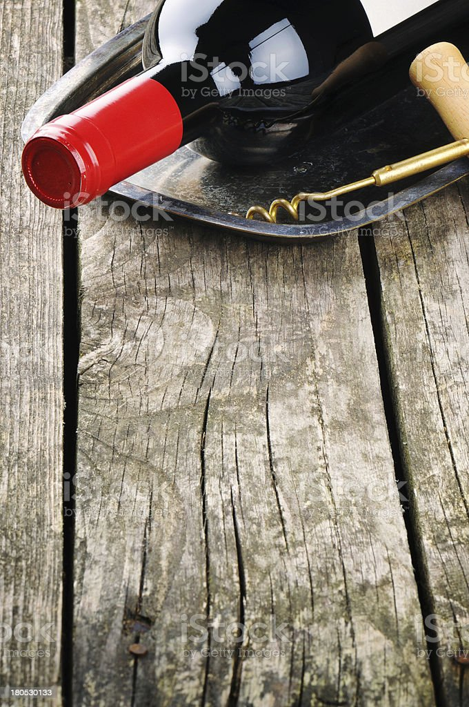 Bottle of red wine and corkscrew royalty-free stock photo