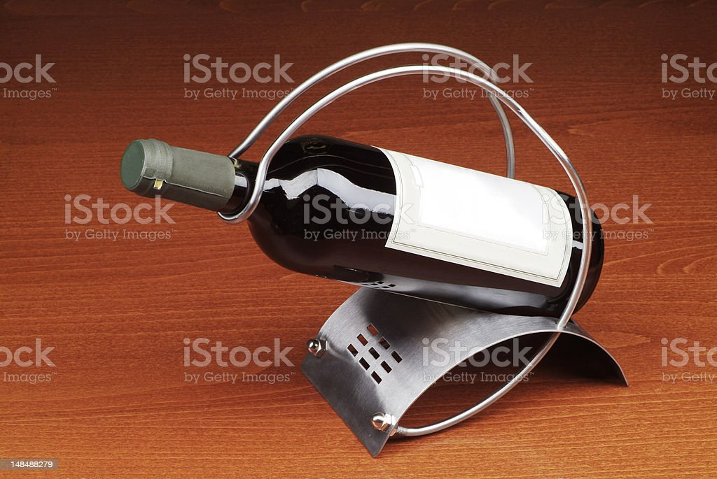 Bottle of red wine in a stand royalty-free stock photo