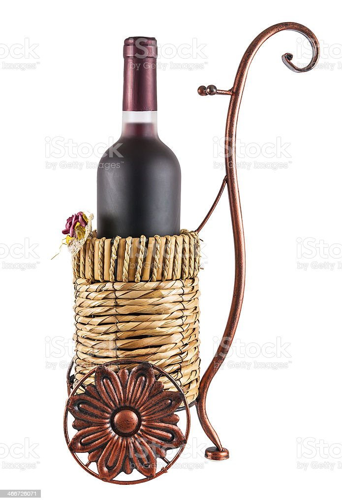 Bottle of red wine in wheeled basket royalty-free stock photo