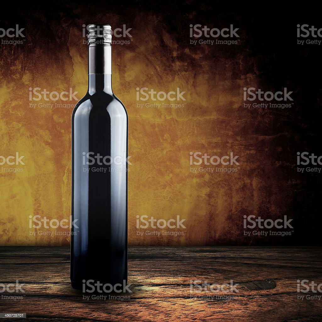 Bottle of red wine on wood table royalty-free stock photo