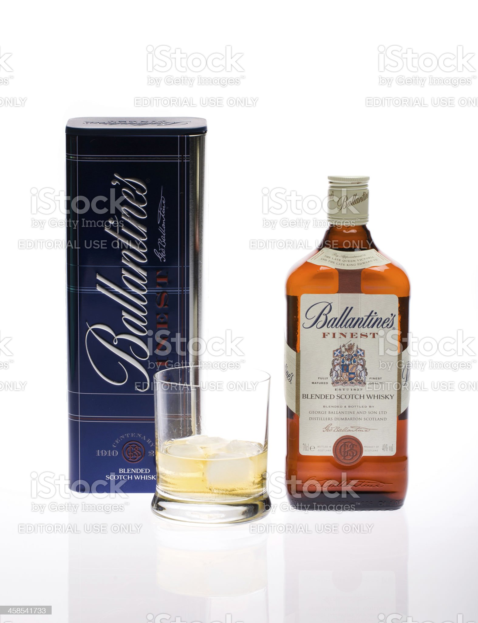 Bottle of scotch whiskey Ballantine's and a glass royalty-free stock photo