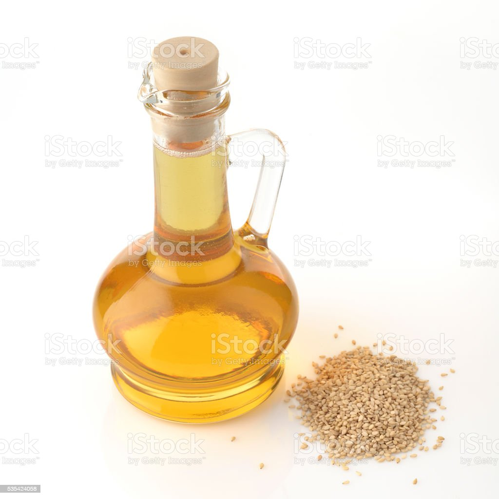Bottle of Sesame Oil on White Background stock photo