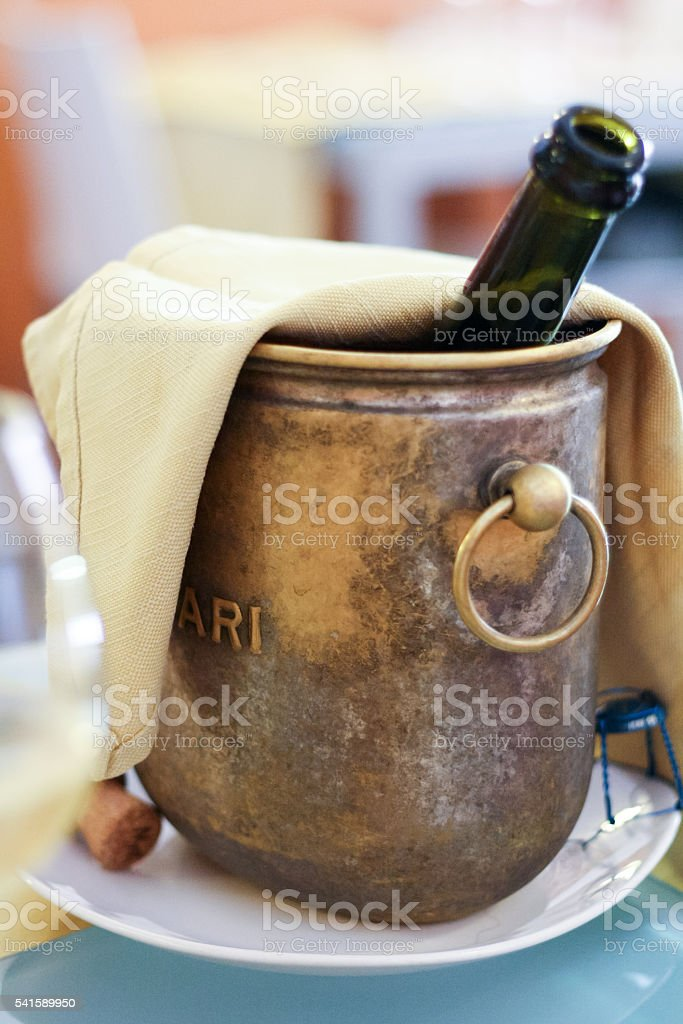 bottle of sparkling wine in a bucket stock photo