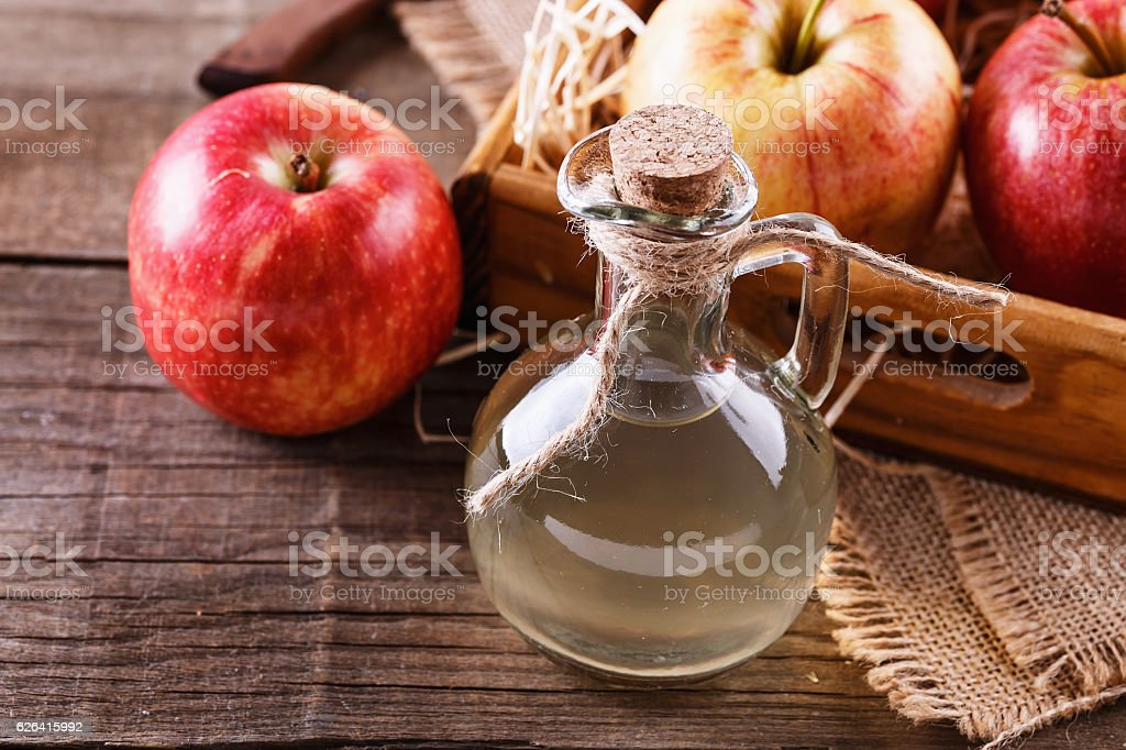 Bottle of unfiltered apple cider vinegar stock photo