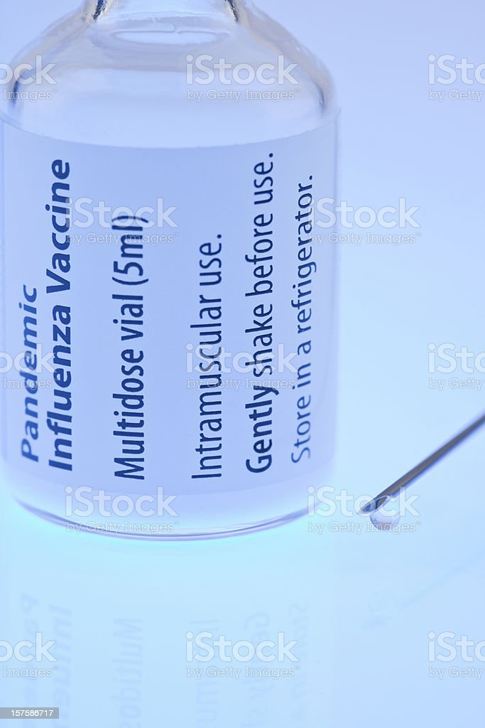Bottle of vaccine with syringe stock photo