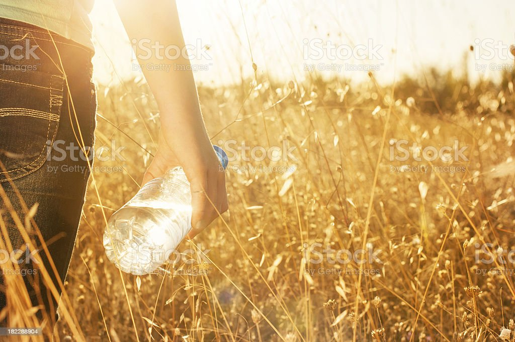 Bottle of water in hand royalty-free stock photo