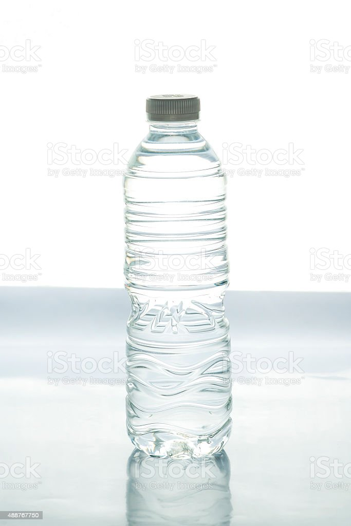 Bottle of water isolated on white, selective focus stock photo