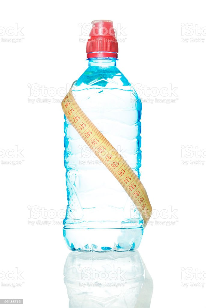 bottle of water with measuring tape wrapped around stock photo