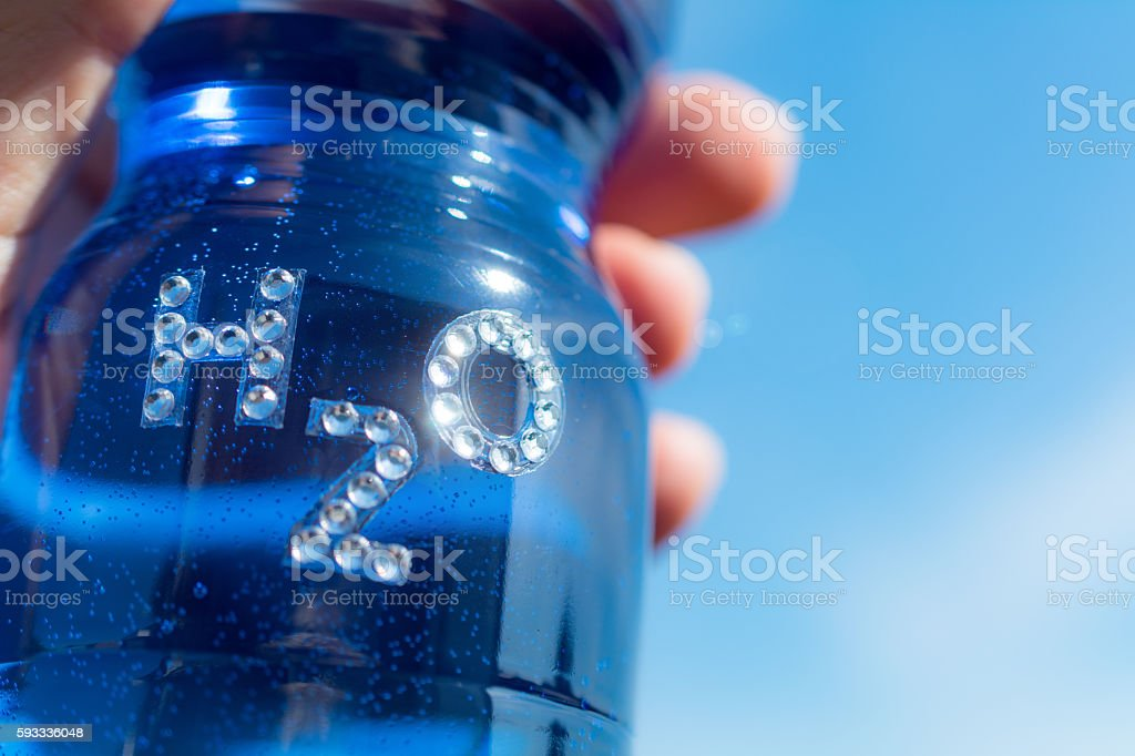 Bottle of water with rhinestone text H20 stock photo