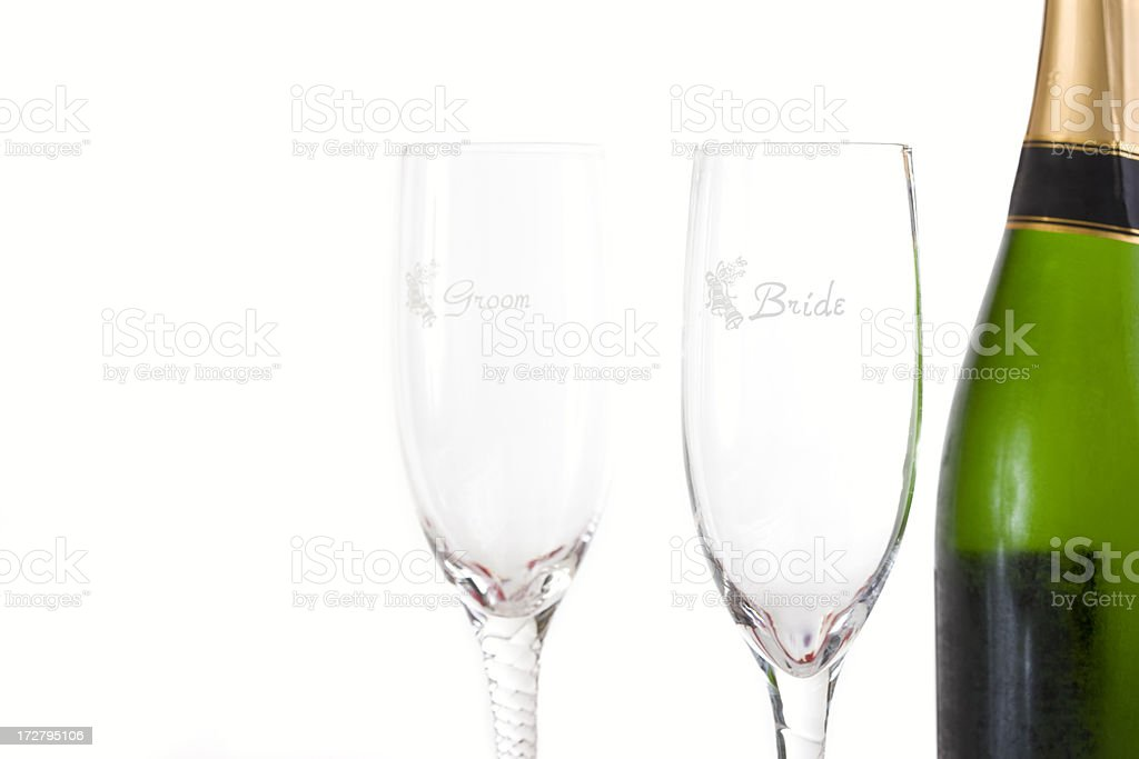 Bottle of Wedding Champagne with Bride and Groom Flutes royalty-free stock photo