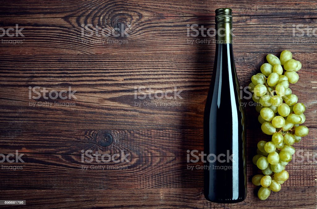 Bottle of white wine and grapes stock photo