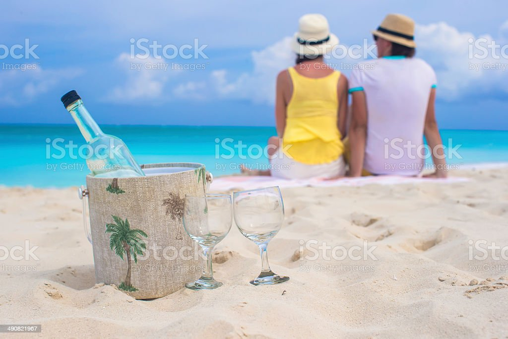Bottle of white wine and two glasses background happy couple royalty-free stock photo