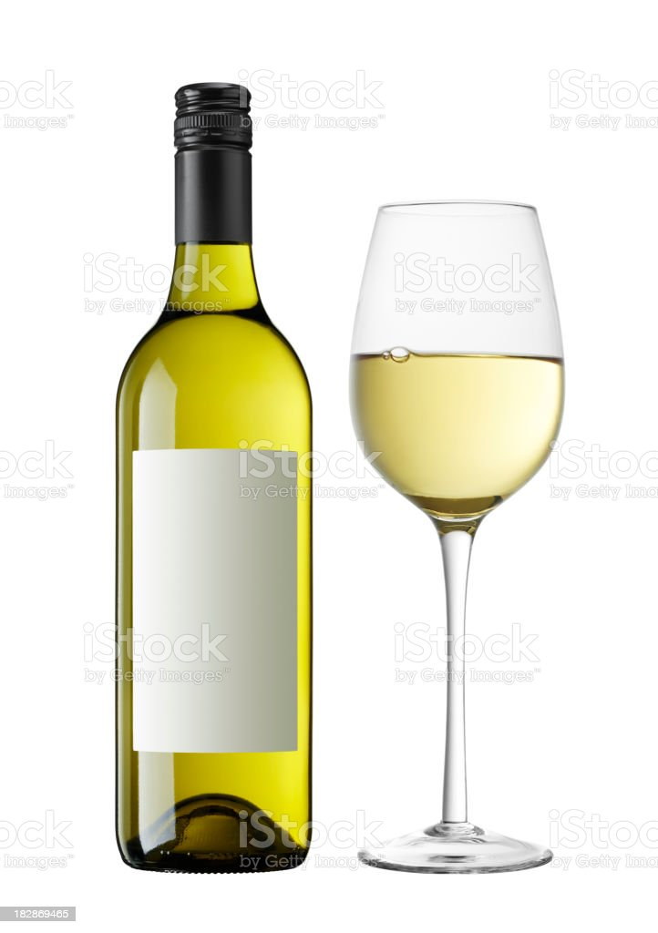 A bottle of white wine next to a wine filled glass royalty-free stock photo