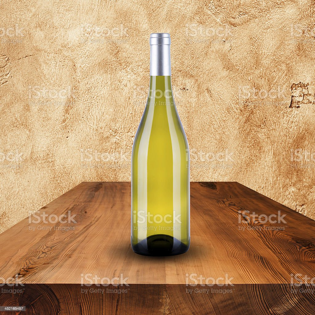 Bottle of white wine on wood table royalty-free stock photo