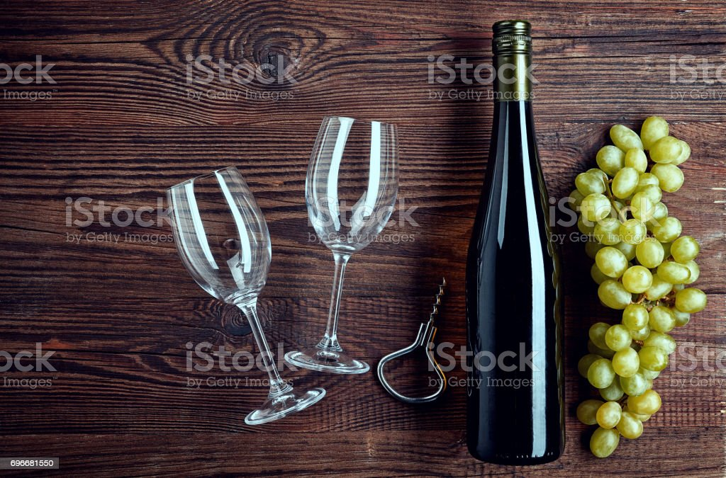 Bottle of white wine, two glasses and grapes stock photo