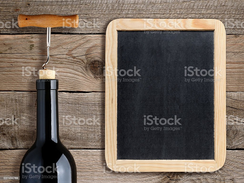 Bottle of wine and blank blackboard stock photo