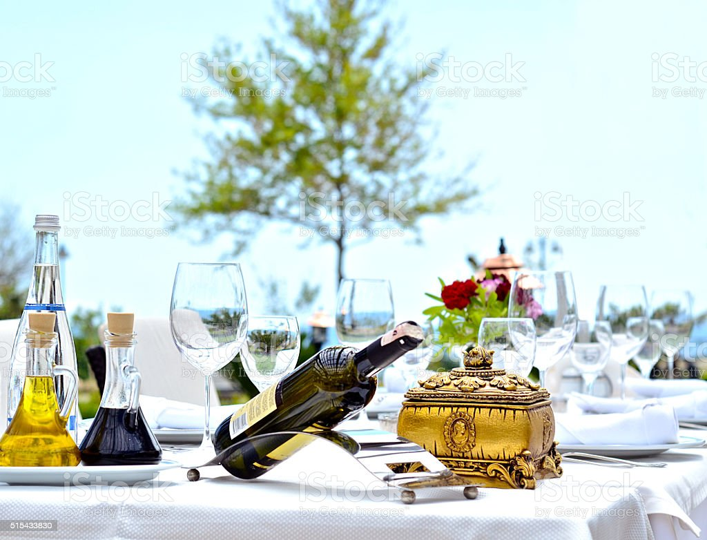 Bottle of wine on the table in the garden stock photo