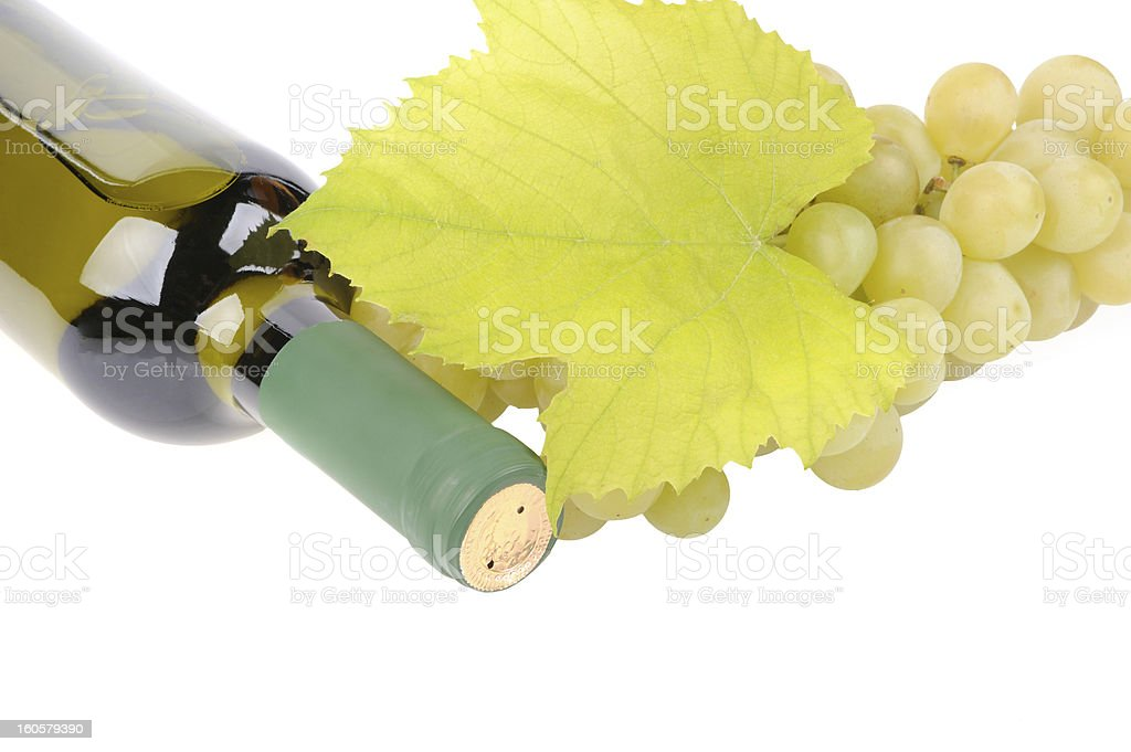 bottle of wine with green grapes royalty-free stock photo