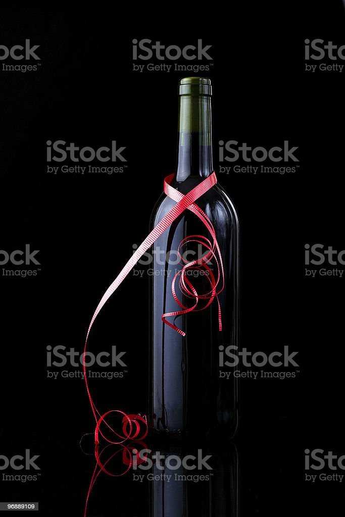 Bottle of  wine wrapped in a red ribbon royalty-free stock photo