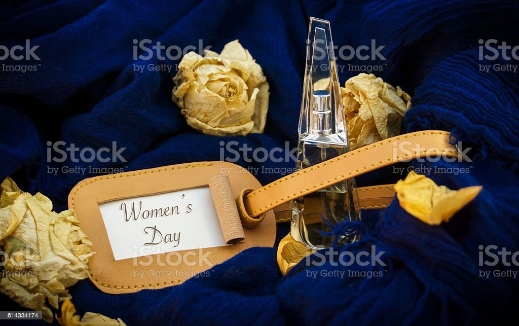 Bottle on a blue background, words on paper stock photo