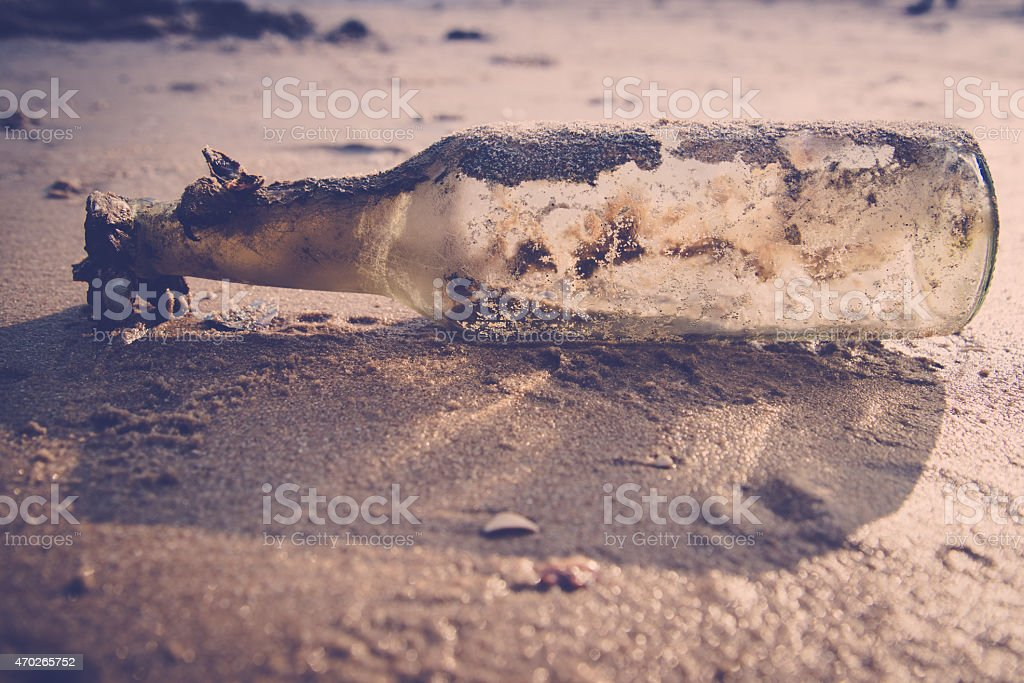 bottle on the beach stock photo