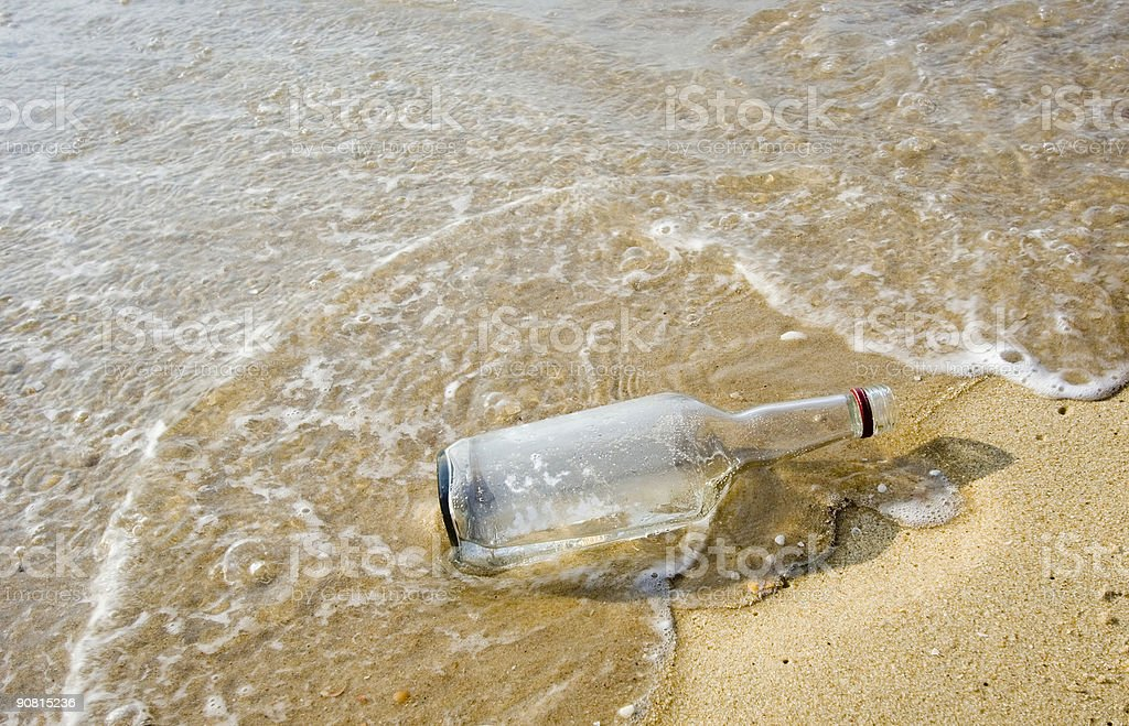 bottle on the beach royalty-free stock photo