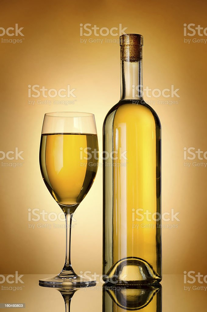 Bottle over gold background royalty-free stock photo