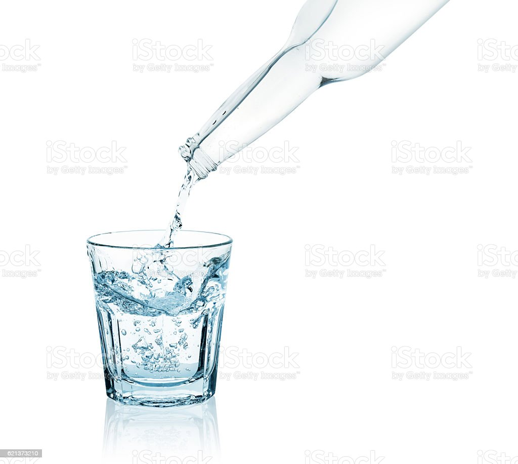 bottle pouring water into a glass stock photo