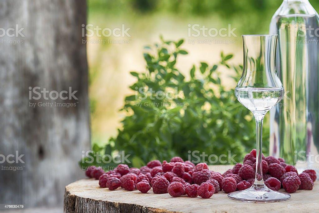 Bottle Raspberry Fruit Brandy  Himbeerschnaps Obstler stock photo